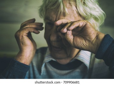 Old women  is crying