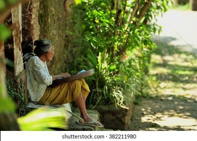 Old women sitting at Tenganan Village (Bali Aga), East Bali, Indonesia