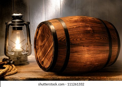 Old wood antique whisky wood barrel or rustic wine keg container with vintage kerosene lamp light lantern in smoke like fog in a smoky nostalgic American waterfront port wooden warehouse