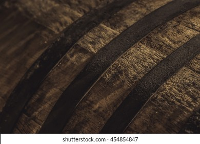 Old wood barrels with old brandy close up