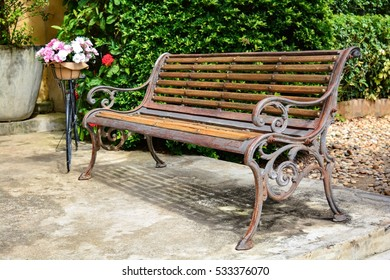 Old wood bench in relaxing zone at home side.