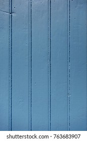 Old wood board painted blue background texture