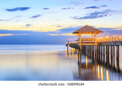 Old wood bridge pier  against beautiful sunset sky use for natural background ,backdrop and multipurpose sea scene