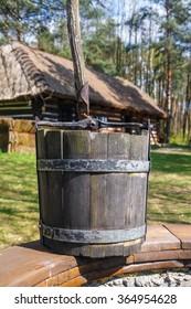 old wood bucket, water well