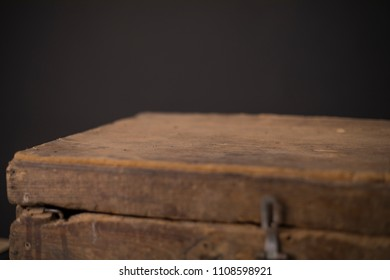 Old wood case on a black Background