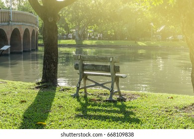 Old wood chair in public park at CHATUCHAK PARK.