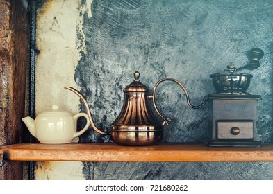 Old wood coffee grinder and mini Coffee jug. Coffee pot on a old dark wooden boards