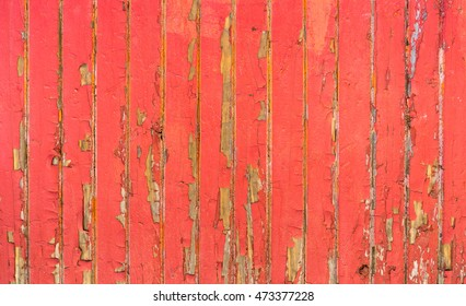 Old wood covered with layers of cracked oil paint.