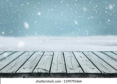 Old wood deck with falling snow in blue freezing tone, for display or montage your products.
