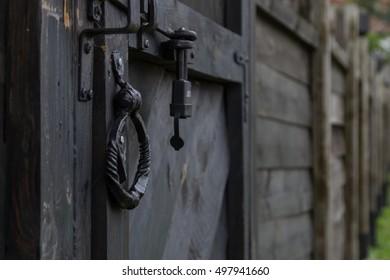 an old wood door with metal handle closeup
