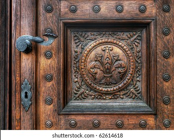 an old wood door with metal handle