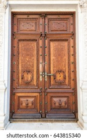 Old wood door on Peles museum, Sinaia Romania.