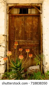 Old wood door with orange flowers in Kritsa village, Crete, Greece