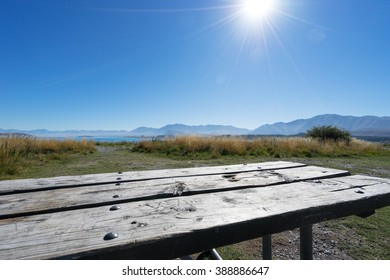 old wood floor on ground near lake in summer day in new zealand