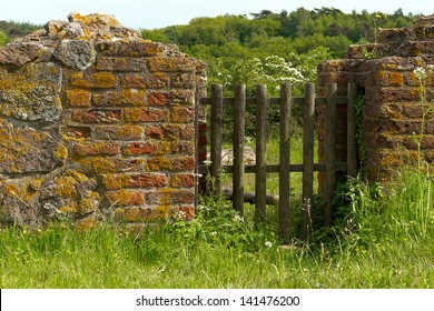 Old wood gate in the brick wall