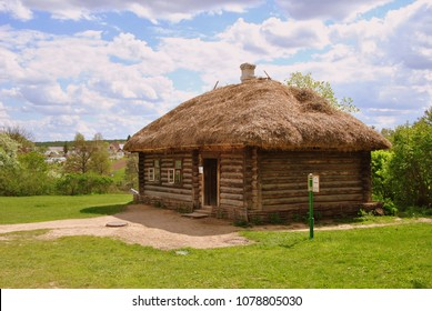 """Old wood house in countryside. Translation of the inscription on the plate from Russian to English: """"Coachman house"""""""