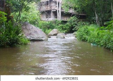 Old wood house in the jungle and stream