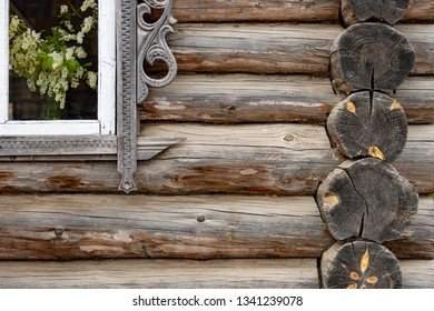 Old wood log background with cracks and lines. Window on wall of house.