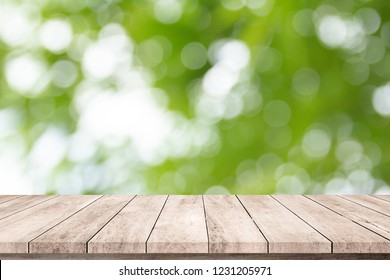 Old wood plank with abstract natural green blurred bokeh background for product display