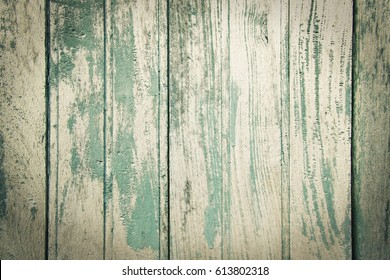 Old wood planks texture background with grungy blue painted.