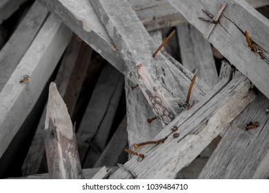 old wood with rusty nails in construction dump site, wasted materials from industrial
