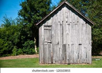 Old wood shack or cabin  against a beautiful bright blue sky