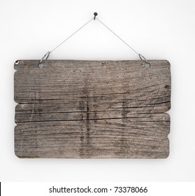 Old wood sign hanging on white wall