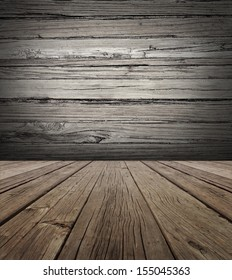 Old wood stage background with vertical natural distressed antique wooden plank floor and horizontal weathered wall as an aged grunge back drop  with copy space.