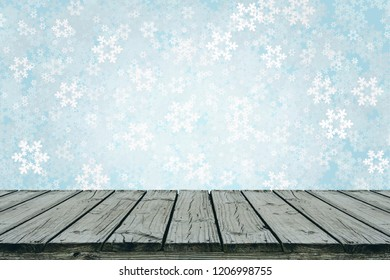 Old wood table with illustration background of falling snow in blue freezing tone, for display or montage your products.