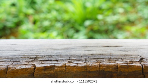 Old wood table top on bokeh Green background