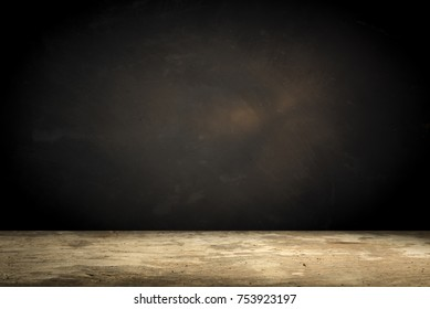 Old wood table top with smoke in the dark background