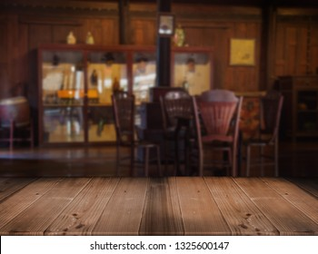 old wood tabletop counter blurred vintage living room with wood decoration Thai Style