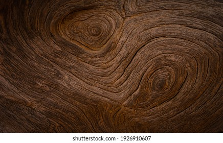 Old wood texture background with natural cracks. Dark brown wood plank is used for background.