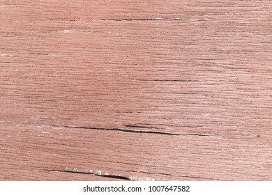 Old wood texture with fissures in brown color. Fissured old paint