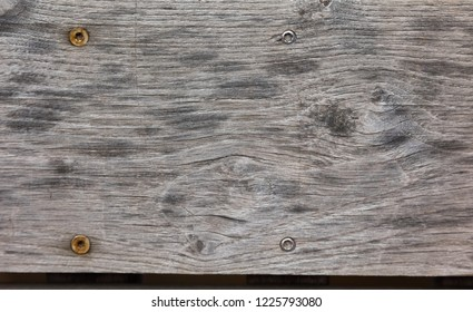 Old wood texture with the rusty screws