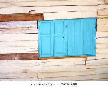 old wood wall with blue window
