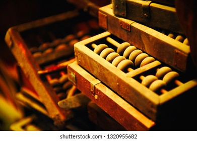 Old wooden abacus covered by dust. Shallow deep of field.
