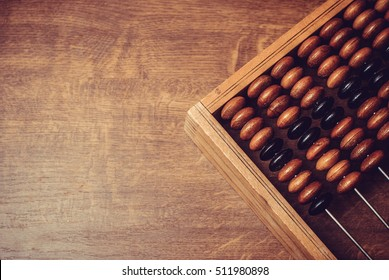 old wooden abacus on wooden background