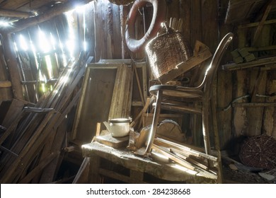 old wooden abandoned barn interior with bright sun beams fallen through cracks in the wall