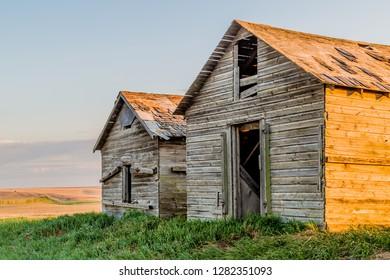 Old wooden abandoned grain bins in a field near Trochu, Alberta