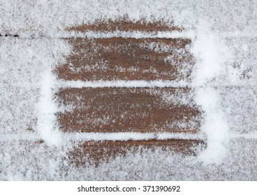 Old wooden background covered with snow. Christmas framework