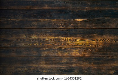 Old wooden background in rustic style. Dark wooden background with the structure and pattern of boards and panels. Copy space.