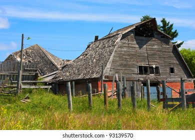 Old wooden barn falling apart and weathered over time