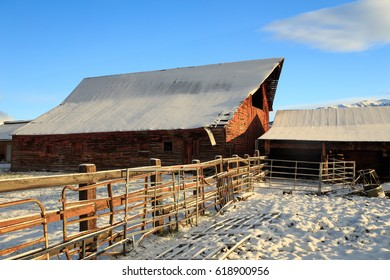 Old wooden barn with fresh snow in rural Utah, USA.