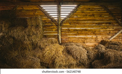 Old wooden barn with haystacks
