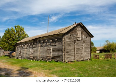 Old wooden barn, where flour is stored from the mill.