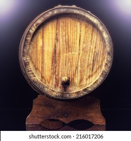 Old wooden barrel isolated on dark background.