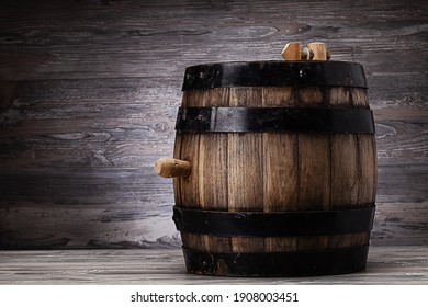 Old wooden barrel standing on table in old cellar