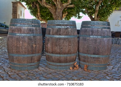 Old wooden barrel standing on the ground