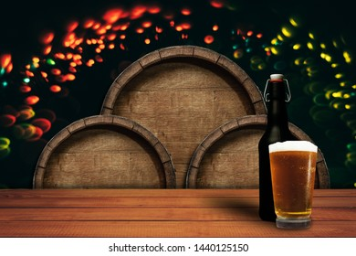 Old wooden barrel and wood table.  Beautiful light bokeh background.
